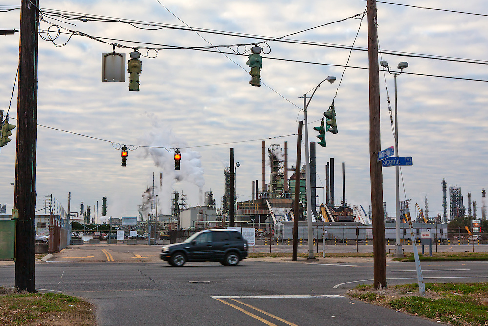 "Exxon Mobile refinery in Baton Rouge, Louisiana on Scenic Highway located in the stretch between Baton Rouge and New Orleans along the river, is part of a large concentration of chemical and oil companies that was formerly referred to as the ""Petrochemical Corridor,"" but now is know as ""Cancer Alley.""  Many cases of cancer have occurred  in communities on both sides of the river though the Louisiana Tumor Registry claims the numbers are not higher then the national average. The record high levels of the Mississippi River in the spring of 2011 brought on by what some scientists classify as climate change,  threaten the environment with the potential flooding of industrial complexes and nuclear facilities along the river."