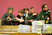 Catherine Connolly far left and her ballot papers and supporters at the Galway West count on Monday Evening. Photo:Andrew Downes