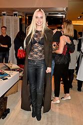 OLGA AKHUNOVA at the Roger Vivier 'The Perfect Pair' Frieze cocktail party celebrating Ambra Medda & 'Miss Viv' at the Roger Vivier Boutique, Sloane Street, London on 15th October 2014.