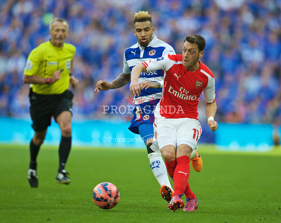 LONDON, ENGLAND - Saturday, April 18, 2015: Arsenal's Mesut Ozil in action against Reading during the FA Cup Semi-Final match at Wembley Stadium. (Pic by David Rawcliffe/Propaganda)