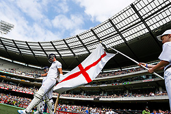 © Licensed to London News Pictures. 27/12/2013. Kevin Pietersen Walks out to bat with Tim Bresnan at the start of play during Day 2 of the Ashes Boxing Day Test Match between Australia Vs England at the MCG on 27 December, 2013 in Melbourne, Australia. Photo credit : Asanka Brendon Ratnayake/LNP