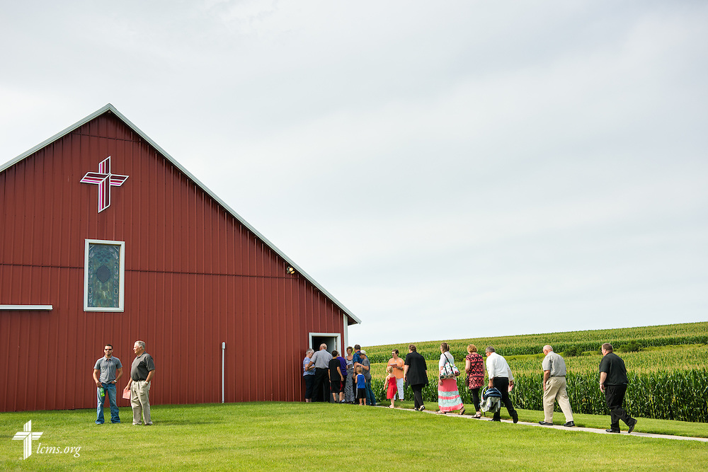 The Rev. David Lyons (far right), pastor of St. Paul Lutheran Church in Schaller, Iowa, leads visitors and members of his congregation to the sanctuary and mission museum for worship at Mission Central on Sunday, July 19, 2015, in Mapleton, Iowa. LCMS Communications/Erik M. Lunsford