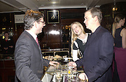Mr and Mrs Harry Enfield. Charity sale of the last ever sale at Asprey and Garrard. New Bond St. London. 15/1/02© Copyright Photograph by Dafydd Jones 66 Stockwell Park Rd. London SW9 0DA Tel 020 7733 0108 www.dafjones.com