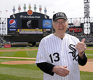 CHICAGO - APRIL 11:  Apollo 13 astronaut James Lovell prepares to throw a ceremonial first pitch on April 11, 2010 at U.S. Cellular Field in Chicago, Illinois.  (Photo by Ron Vesely)