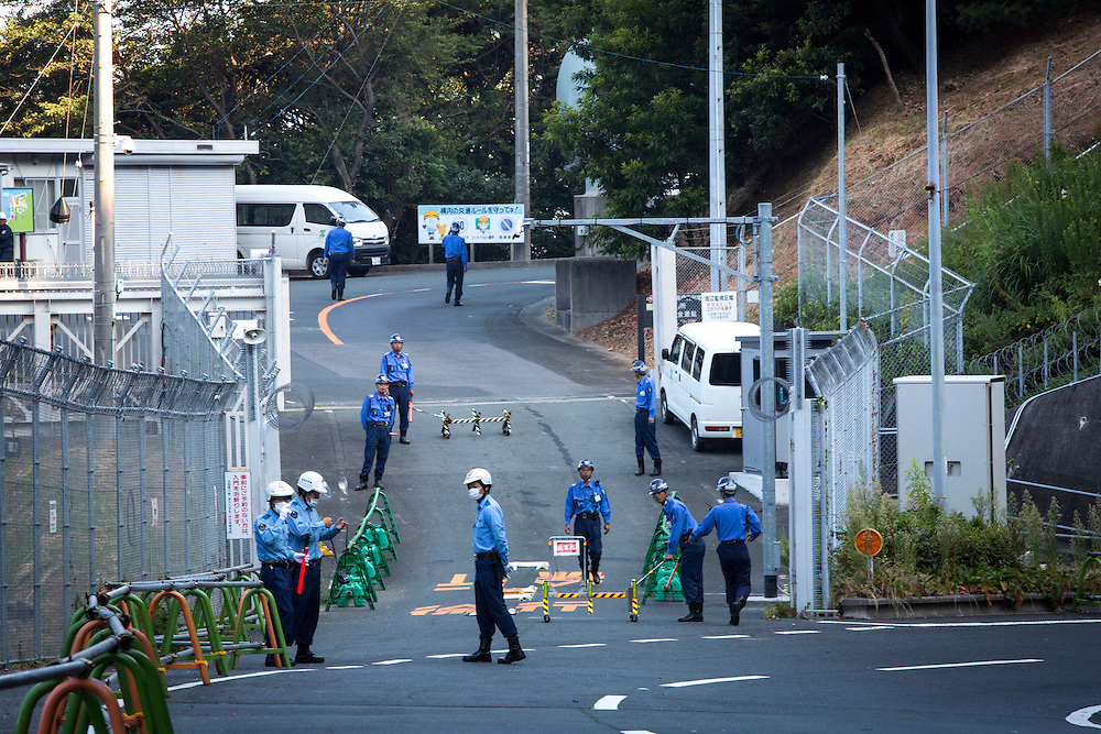 EHIME, JAPAN - AUGUST 11 : Police guard the gate of Ikata Nuclear Power Plant on August 11, 2016 in Ikata, Ehime prefecture, northwestern Shikoku, Japan. The No. 3 reactor of the nuclear plant is expected to resume operations this week after The Nuclear Regulation Authority (NRA's) has completed it's final inspections of the plant's operational safety measures. The plant has not generated nuclear power since Japan's 2011 nationwide shutdown of all nuclear plants in the aftermath of the Fukushima Daiichi nuclear disaster. Ikata Nuclear Power Plant will be the third nuclear power plant in Japan to become operational. (Photo by Richard Atrero de Guzman/NURPhoto)