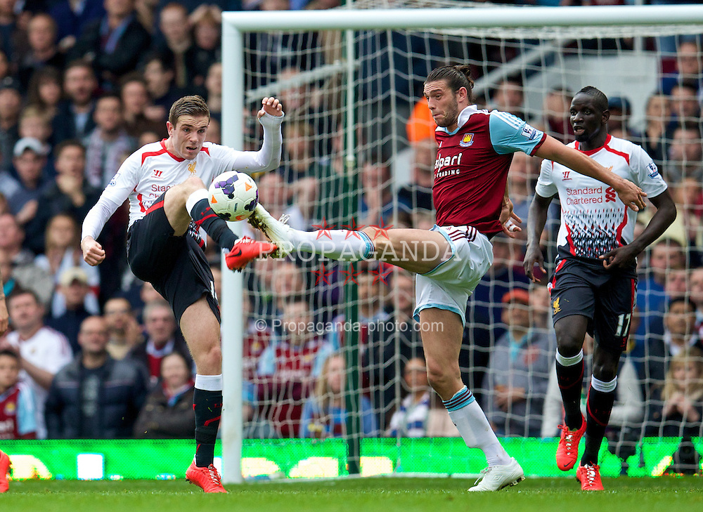 LONDON, ENGLAND - Sunday, April 6, 2014: Liverpool's Jordan Henderson in action against West Ham United's Andy Carroll during the Premiership match at Upton Park. (Pic by David Rawcliffe/Propaganda)