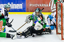 Danny Irmen (EHC Liwest Linz, #9) vs Matija Pintaric (HDD Tilia Olimpija, #69) during ice-hockey match between HDD Tilia Olimpija and EHC Liwest Black Wings Linz at second match in Semifinal  of EBEL league, on March 8, 2012 at Hala Tivoli, Ljubljana, Slovenia. (Photo By Matic Klansek Velej / Sportida)