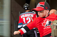 KELOWNA, CANADA - OCTOBER 25: A young fan fist pumps the Kelowna Rockets as they exit the ice for the dressing room at the end of a period against the Brandon Wheat Kings on October 25, 2014 at Prospera Place in Kelowna, British Columbia, Canada.  (Photo by Marissa Baecker/Shoot the Breeze)  *** Local Caption *** Fan;