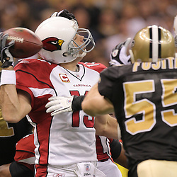 16 January 2010:  Arizona Cardinals quarterback Kurt Warner (13) is sacked by New Orleans Saints linebacker Jonathan Vilma (51) and linebacker Scott Fujita (55) during a 45-14 win by the New Orleans Saints over the Arizona Cardinals in a 2010 NFC Divisional Playoff game at the Louisiana Superdome in New Orleans, Louisiana.