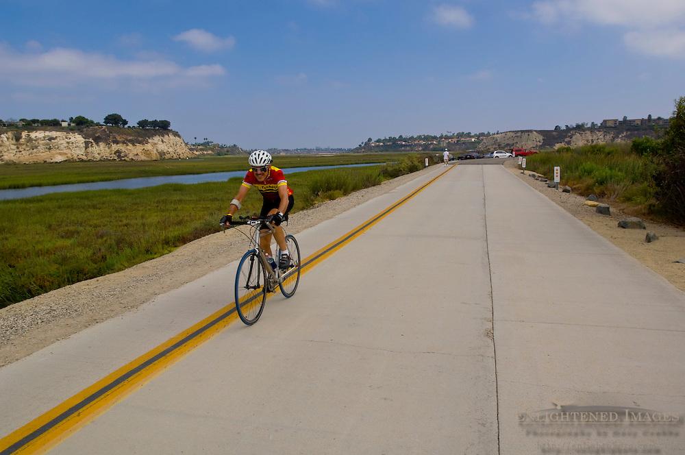 Biker on Back Bay Drive, Upper Newport Bay Ecological Reserve, Newport Beach, Orange County, California