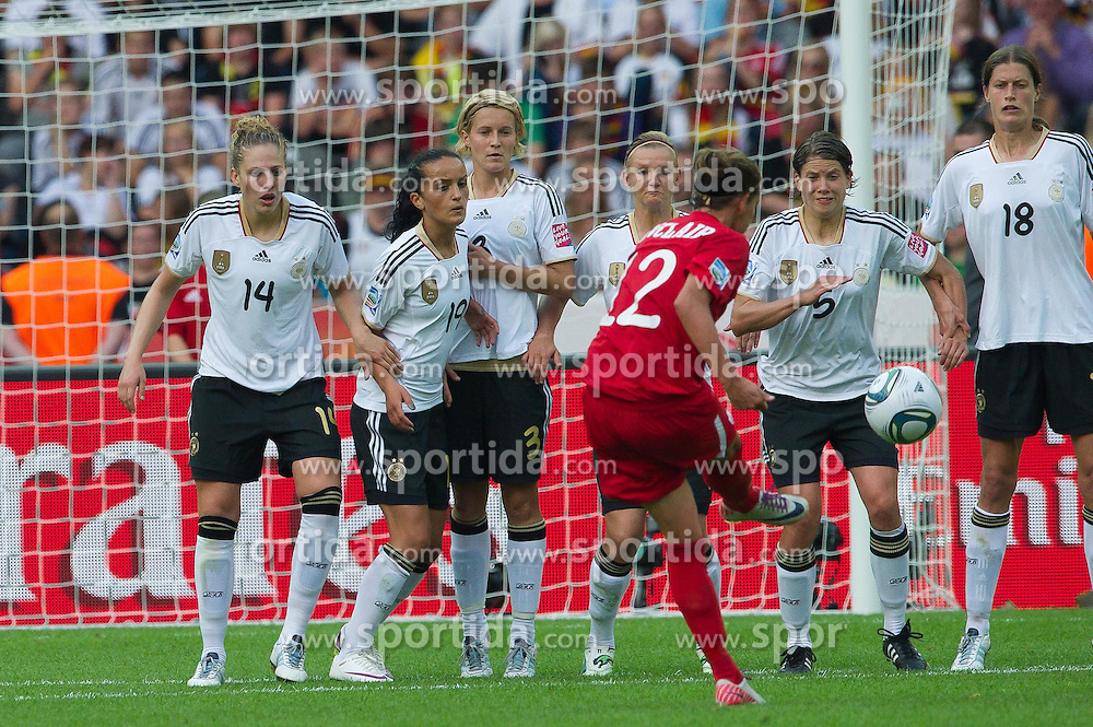 26.06.2011, Olympiastadion Berlin, Berlin, GER, FIFA Women's Worldcup 2011, Gruppe A,  Deutschland (GER) vs. Canada (CAN), im Bild Anbschlusstreffer zum 2:1 durch 12 Christine SINCLAIR in der Mauer Kim Kulig (GER #14, Hamburg) Merstin Garefrekes (GER #18, Frankfurt) Saskia Bartusiak (GER #03, Frankfurt) Alexnadra Popp (GER11 #11, Duisburg) Annike Krahn (GER #05, Duisburg) Merstin Garefrekes (GER #18, Frankfurt) // during the FIFA Women's Worldcup 2011, Pool A, Germany vs Canada on 2011/06/26, Olympiastadion, Berlin, Germany.   EXPA Pictures © 2011, PhotoCredit: EXPA/ nph/  Kokenge       ****** out of GER / SWE / CRO  / BEL ******