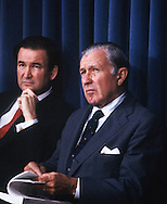 Doanld Regan and Pat Buchanan listen to President Roanld Reeagan at an event in October 1985.<br /> Photo by Dennis Brack