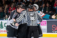 KELOWNA, CANADA - JANUARY 4: Tim Traber RW #21 of the Vancouver Giants is separated by linesmen from Tyrell Goulbourne #12 of the Kelowna Rockets after the two dropped the gloves on January 4, 2014 at Prospera Place in Kelowna, British Columbia, Canada.   (Photo by Marissa Baecker/Shoot the Breeze)  ***  Local Caption  ***