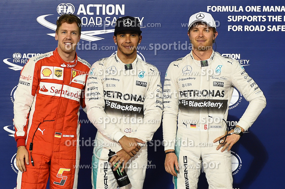 18.04.2015, International Circuit, Sakhir, BHR, FIA, Formel 1, Grand Prix von Bahrain, Qualifying, im Bild (L to R): Sebastian Vettel (GER) Ferrari, pole sitter Lewis Hamilton (GBR) Mercedes AMG F1 and Nico Rosberg (GER) Mercedes AMG F1 in parc ferme // during Qualifying of the FIA Formula One Bahrain Grand Prix at the International Circuit in Sakhir, Bahrain on 2015/04/18. EXPA Pictures &copy; 2015, PhotoCredit: EXPA/ Sutton Images/ Mark<br /> <br /> *****ATTENTION - for AUT, SLO, CRO, SRB, BIH, MAZ only*****