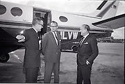 25/06/1965<br /> 06/25/1965<br /> 25 June 1965<br /> Arrival of Dr Carl H. Hahn of Volkswagen at Dublin Airport.<br /> Dr. Hahn, Sales and Service Director, Volkswagenwerke, A.G., Germany, arrived in Ireland on the company plane. He was President of Volkswagen of America. He had recently returned to Wolfsburg and was visiting Ireland as part of a brief European tour to familiarise himself with local conditions. Image shows Michael P. O'Flaherty; Dr. Hahn and S. O'Flaherty.