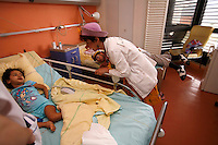 Clowns visit sick children in the cancer blood disease floor in Hospital St. Louis, a public assistance hospital, Paris..April 7, 2006..