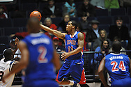 """SMU's London Giles (11) has his shot blocked by Ole Miss' Reginald Buckner (23) at the C.M. """"Tad"""" Smith Coliseum in Oxford, Miss. on Tuesday, January 3, 2012. Ole Miss won 50-48."""