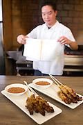 Chef Bryant Ng with lamb satay and chicken satay