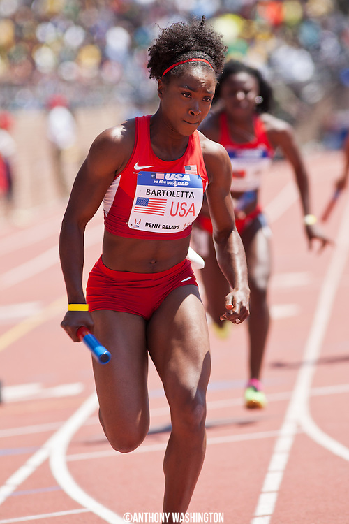 Tianna Bartoletta with the USA Red team runs the first leg of the USA vs. the World Women's 4x100 at the 119th Penn Relays on Saturday, April 27, 2013 in Philadelphia, PA.