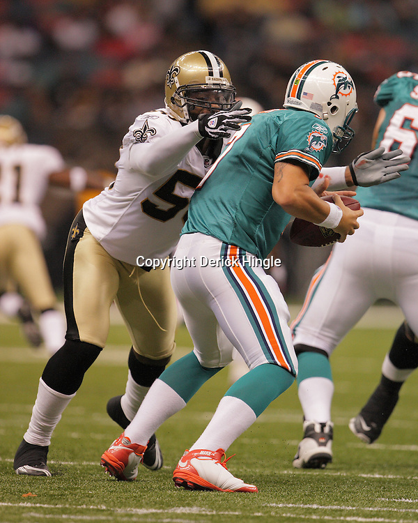 2008 August 28: New Orleans Saints linebacker Marvin Mitchell (50) grabs Miami Dolphins quarterback Chad Henne (7) for a sack during their preseason game at the Louisiana Superdome in New Orleans, LA.