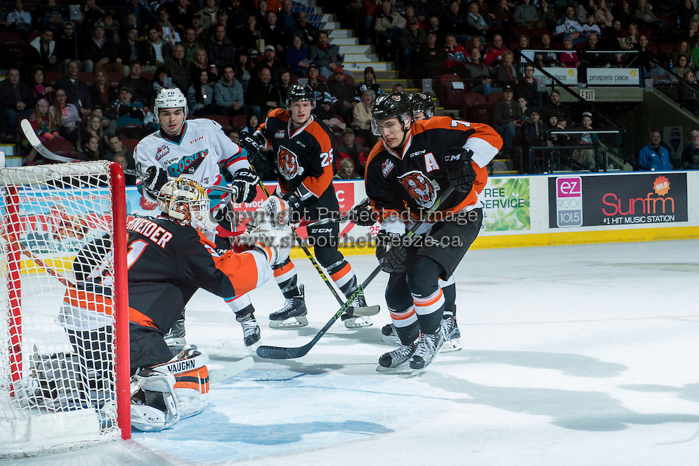 KELOWNA, CANADA - JANUARY 23: Nick Schneider #31 of Medicine Hat Tigers makes a save on a shot by Nick Merkley #10 of Kelowna Rockets on January 23, 2016 at Prospera Place in Kelowna, British Columbia, Canada.  (Photo by Marissa Baecker/Shoot the Breeze)  *** Local Caption *** Nick Schneider; Nick Merkley;