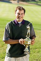 Golfer Holding Trophy