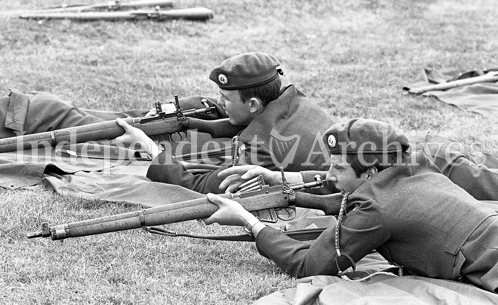 Pte Jim Woolhan(L) and Pte Gus Huszar with C Company Wicklow, Practive with the 303 Lee-Enfield SMLE No 3 at the 21st Infantry Battalion Summer Camp at Gormanston Camp, Meath, 05/08/1982 (Part of the Independent Newspapers Ireland/NLI Collection).