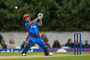 Hashmatullah Shaidi of Afghanistan plays a shot in the rain during the One Day International match between Scotland and Afghanistan at The Grange Cricket Club, Edinburgh, Scotland on 10 May 2019.