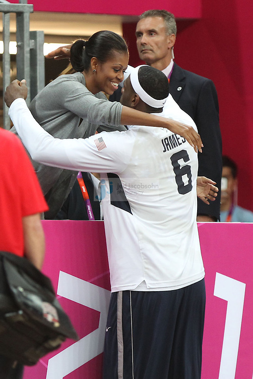 First Lady Michelle Obama hugs LeBron James during a USA basketball game against France during Day 2 of the London Olympic Games in London, England, United Kingdom on 29 Jul 2012..(Jed Jacobsohn/for The New York Times)....