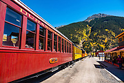 Fall colors at the railroad station in Silverton. The Durango and Silverton Narrow Gauge Railroad, a National Historic Landmark, links Durango to Silverton, in Colorado, USA. Silverton is a former silver mining camp, now the federally-designated Silverton Historic District. Silverton no longer has active mining, but subsists on tourism, maintenance of US 550 (which links Montrose with Durango), mine pollution remediation, and retirees.