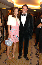ARABELLA MUSGRAVE and the HON.JAMES TOLLEMACHE at a dinner in aid of the BAAF (British Association for Adoption & Fostering) held at The Savoy, London on 22nd March 2005.<br />