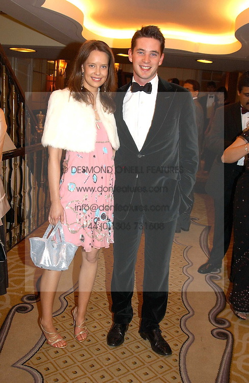 ARABELLA MUSGRAVE and the HON.JAMES TOLLEMACHE at a dinner in aid of the BAAF (British Association for Adoption &amp; Fostering) held at The Savoy, London on 22nd March 2005.<br />