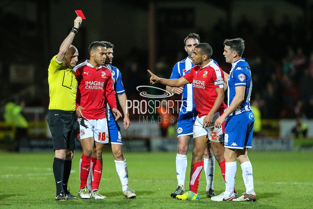 Swindon defender Nathan Thompson is shown a red card by referee Andy Davies during the Sky Bet League 1 match between Swindon Town and Wigan Athletic at the County Ground, Swindon, England on 25 March 2016. Photo by Shane Healey.