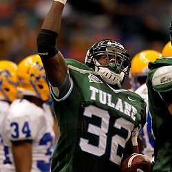 Sep 26, 2009; New Orleans, LA, USA;  Tulane Green Wave running back Andre Anderson (32) celebrates after scoring a touchdown against the McNesse State Cowboys at the Louisiana Superdome. Tulane defeated McNeese State 42-32. Mandatory Credit: Derick E. Hingle-US PRESSWIRE