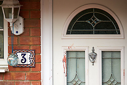 © Licensed to London News Pictures. 20/10/2019. Milton Keynes, UK. Blood is seen on a front door (number visible) at the scene in Archford Croft in Emerson Valley where two 17 year old boys were stabbed to death overnight. Two adult males where also injured. Thames Valley Police have begun a doyuble murder investigation but have yet to make any arrests.  Photo credit: Cliff Hide/LNP