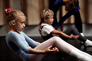 Royal Ballet School Copenhagen. Children taking dance classes do exercises at the beginning of a class. Denmark.