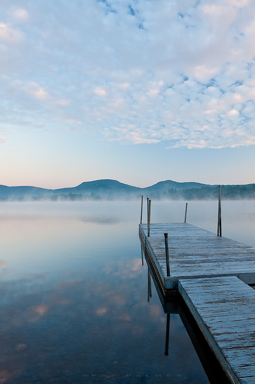 Adirondacks, NY.<br /> A few minutes before sunrise, fog tiptoes across the surface of Blue Mountain Lake.