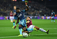 Football - 2018 / 2019 EFL Carabao (League) Cup - Fourth Round: West Ham United vs. Tottenham Hotspur<br /> <br /> Tottenham Hotspur's Serge Aurier is tackled by West Ham United's Ryan Fredericks, at the London Stadium<br /> <br /> COLORSPORT/ASHLEY WESTERN