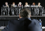 Assemblywoman Sandra Galef, second from left at table, talks to Orange County Director of Real Property Services John McCarey, front, after McCarey spoke at a public hearing on property taxes at the Paramount Theater in Middletown on Sept. 26, 2007. Also seated at the table from the Assembly are: Kevin Cahill, Nancy Calhoun, Aileen Gunther, Ann Rabbitt and Ellen Jaffee.