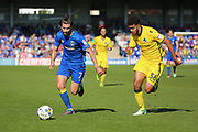 AFC Wimbledon defender George Francomb (7) taking on Bristol Rovers defender Jake Clarke-Salter (36) during the EFL Sky Bet League 1 match between AFC Wimbledon and Bristol Rovers at the Cherry Red Records Stadium, Kingston, England on 8 April 2017. Photo by Matthew Redman.