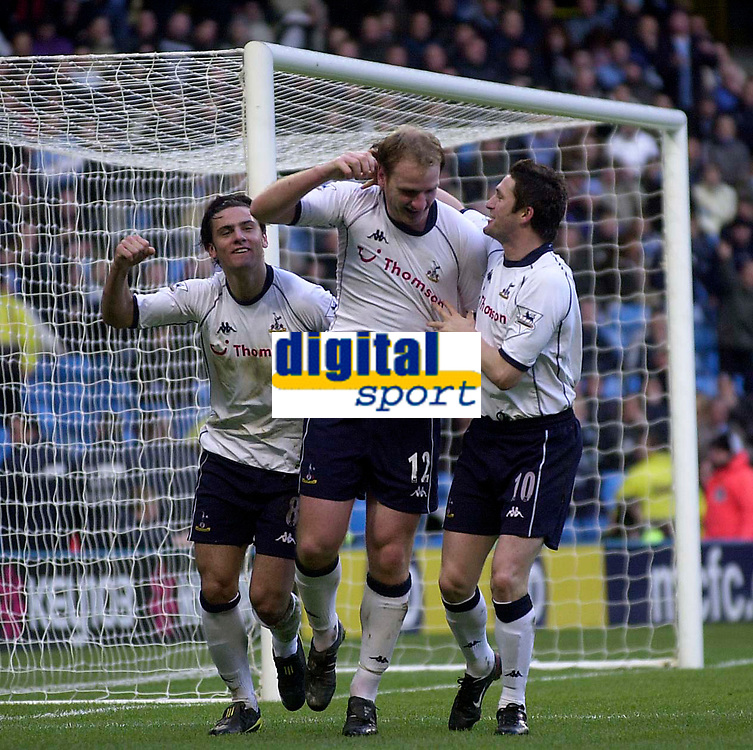Photo. Glyn Thomas.<br /> Manchester City v Tottenham Hotspur. FA Cup fourth round. <br /> City of Manchester Stadium, Manchester. 25/01/2004.<br /> Spurs' Gary Doherty (C) celebrate putting his side level with Helder Postiga (L) and Robbie Keane.