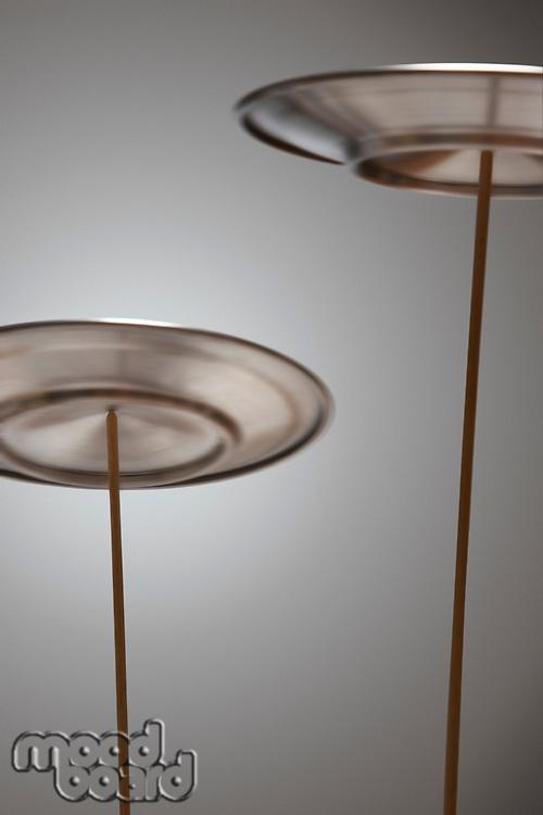 Plates Spinning on Sticks