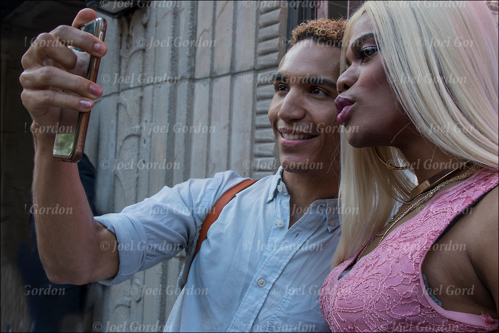 Justin Sams and friend taking selfie.<br /> <br /> Justin Sams is an gay actor and writer, he is best known for Pink (2017), Last Men (2016), First Dates (2015) and Deadman's Barstool.<br /> <br /> Raise the Rainbow!  Gilbert Baker Memorial Rally March NYC Worldwide, Flag Day June 14, 2017. Rally : Christopher Street at Sonewall and March to Hudson River Park.<br /> <br /> The rainbow flag a symbol of lesbian, gay, bisexual and trans gender (LGBT) pride and diversity. <br /> <br /> The different colors symbolize diversity in the gay community.<br />  <br /> The rainbow is use in various forms including banners, clothing and jewelry.