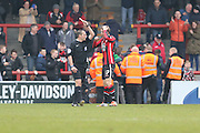 Andrew Fleming of Morecambe FC see a yellow card after putting Morecambe 1-0 up during the Sky Bet League 2 match between Morecambe and AFC Wimbledon at the Globe Arena, Morecambe, England on 12 March 2016. Photo by Stuart Butcher.