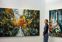 © Licensed to London News Pictures. 21/01/2020. London, UK. A woman views John Morris' artwork titled 'Nature' during the preview of London Art Fair at Business Design Centre in north London. The fair opens on 22 January and runs until 26 January, which showcases modern and contemporary artwork from galleries around the world. Photo credit: Dinendra Haria/LNP