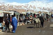 A woman and her son are waling along the bazaar in the centre of Bamyan, central Afghanistan, an area mostly populated by Hazaras. A historically persecuted minority (15%) due to more lenient Islamic faith and characteristic 'Eastern' lineaments, Hazaras constitute the 70% of Bamyan's population.