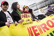 Frankfurt | 18 March 2017<br /> <br /> Am Samstag (18.02.2017) feierten &uuml;ber 30000 Kurden im Rahmen einer Demonstration das kurdische Neujahrsfest Newroz, bei der Demo sprachen sie sich gegen eine Diktatur und f&uuml;r die Freilassung von PKK-F&uuml;hrer Abdullah &Ouml;calan aus.<br /> Hier: Eine junge Frau tr&auml;gt ein kleines Plakat mit der Aufschrift &quot;Nein zur Diktatur&quot;.<br /> <br /> photo &copy; peter-juelich.com<br /> <br /> Nutzung honorarpflichtig!
