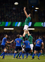Devin Toner of Ireland rises high to win lineout ball - Mandatory byline: Patrick Khachfe/JMP - 07966 386802 - 11/10/2015 - RUGBY UNION - Millennium Stadium - Cardiff, Wales - France v Ireland - Rugby World Cup 2015 Pool D.