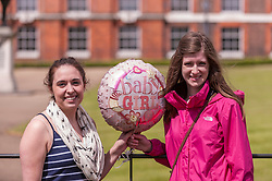 © Licensed to London News Pictures. 03/05/2015. London, UK. Tourists from Canada pose with a balloon tied to a railing outside the Golden Gates at Kensington Palace for the new daughter of the Duke and Duchess of Cambridge who was born the previous day. Photo credit : Stephen Chung/LNP
