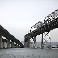 The San Francisco-Oakland Bay Bridge is under construction, and scheduled to open Labor Day 2013. The Self-Anchored Suspension Span (SAS) is the largest bridge of its kind in the world measuring 2,047 feet. This engineering and construction marvel raises the bridge building bar to new heights, as seen in these behind the scenes photos taken on Monday, March 18, 2013. In this Eastern facing image, the newly created spans are seen on the left, and the original bridge is seen on the right.  (AP Photo/Alex Menendez)